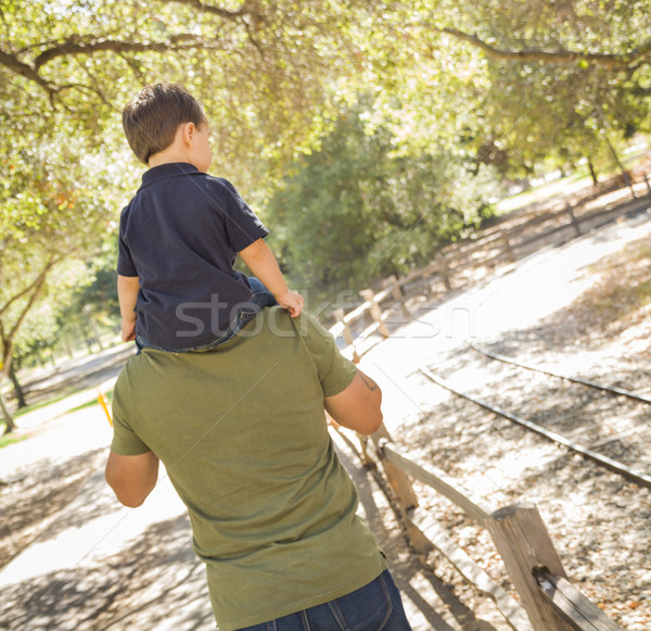 Mixed Race Son Enjoy a Piggy Back in the Park with Dad Stock photo © feverpitch