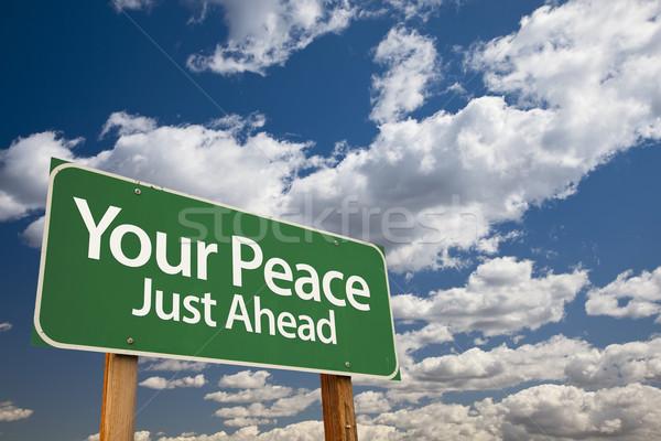 Paz verde placa sinalizadora dramático nuvens céu Foto stock © feverpitch