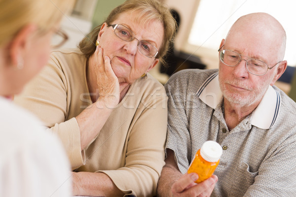 Doctor or Nurse Explaining Prescription Medicine to Senior Coupl Stock photo © feverpitch