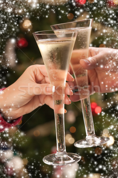 Man and Woman Toasting Champagne in Front of Lights Stock photo © feverpitch