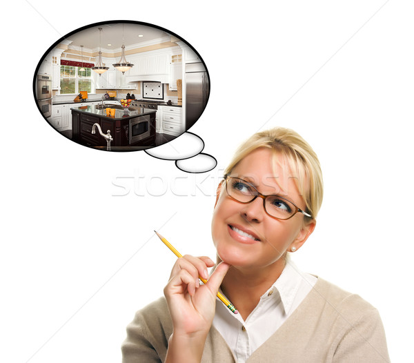 Woman with Thought Bubbles of a New Kitchen Design Stock photo © feverpitch