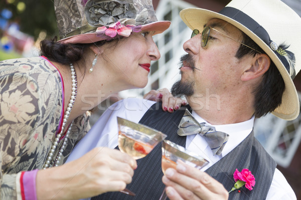 Mixed-Race Couple Dressed in 1920's Era Fashion Sipping Champagne Stock photo © feverpitch