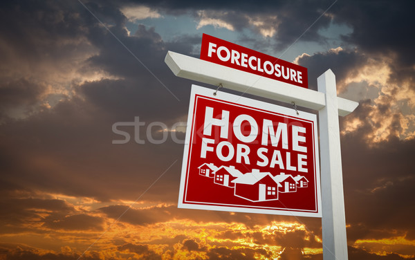 Red Foreclosure Home For Sale Real Estate Sign Over Sunset Sky Stock photo © feverpitch
