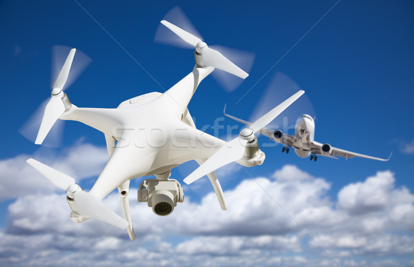 Unmanned Aircraft System (UAV) Quadcopter Drone In The Air Too C Stock photo © feverpitch