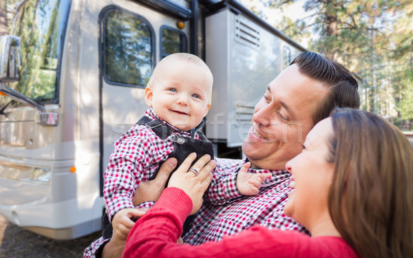 Happy Young Caucasian Family In Front of Their Beautiful RV At T Stock photo © feverpitch