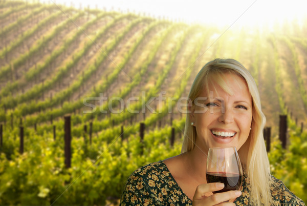 Attractive Young Woman With Wine Glass in A Vineyard. Stock photo © feverpitch