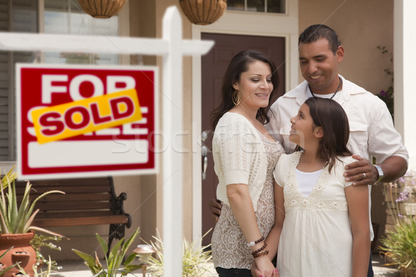 Hispanic Family in Front of Home with Sold Real Estate Sign Stock photo © feverpitch