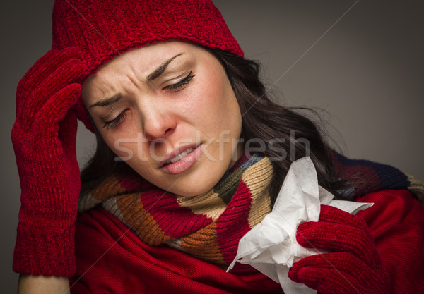 Miserable Mixed Race Woman Blowing Her Sore Nose with Tissue Stock photo © feverpitch