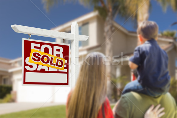 Family Facing Sold For Sale Real Estate Sign and House Stock photo © feverpitch