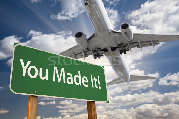 Stock photo: You Made It Green Road Sign and Airplane Above