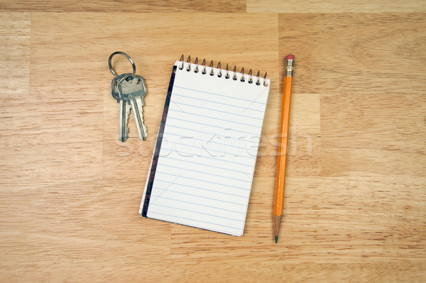 Pad of Paper, Pencil and Keys Stock photo © feverpitch