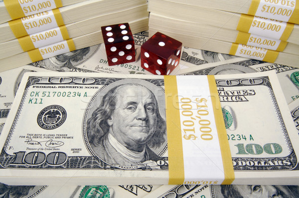 One Hundred Dollar Bills & Red Dice Stock photo © feverpitch
