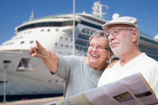 Happy Senior Adult Couple Tourists with Brochure Next To Passeng Stock photo © feverpitch