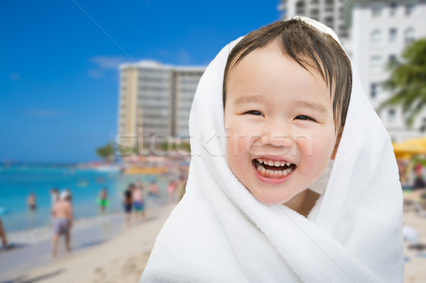Happy Cute Mixed Race Chinese and Caucasian Boy On Waikiki Beach Stock photo © feverpitch