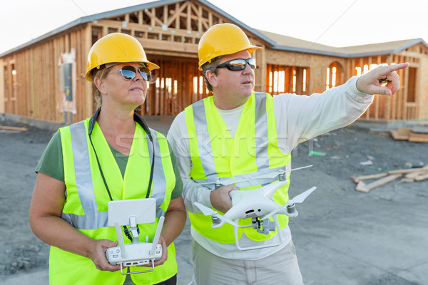 Workers with Drone Quadcopter Inspecting Photographs on Controll Stock photo © feverpitch