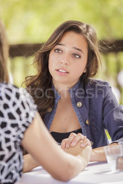 привлекательная девушка утешительный друга сидят улице женщины Сток-фото © feverpitch