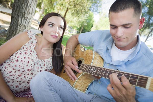 Casal parque jogar guitarra cantando Foto stock © feverpitch