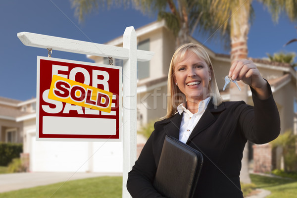Female Real Estate Agent Handing Over the House Keys Stock photo © feverpitch