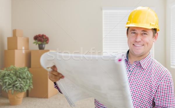 Masculina trabajador de la construcción habitación cajas rodar Foto stock © feverpitch