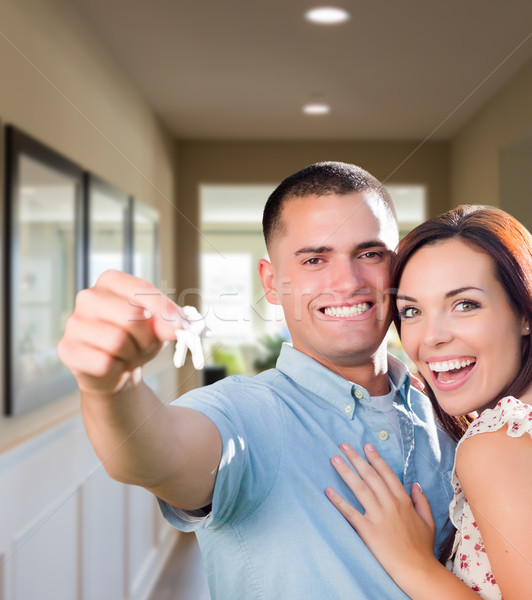 Military Couple with House Keys Inside Hallway Stock photo © feverpitch