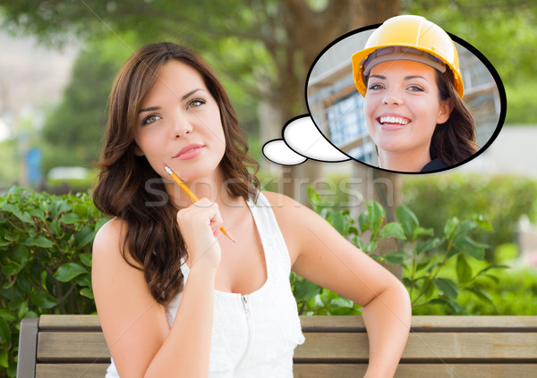 Thoughtful Young Woman with Herself as a Contractor or Builder I Stock photo © feverpitch