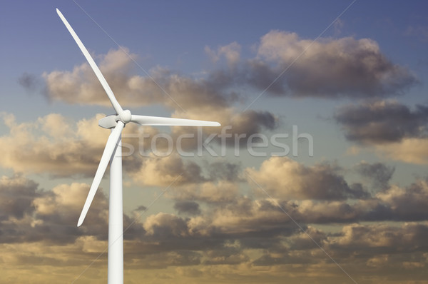 Wind Turbine Over Dramatic Sky and Clouds Stock photo © feverpitch