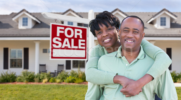 Happy African American Couple In Front of Beautiful House and Fo Stock photo © feverpitch
