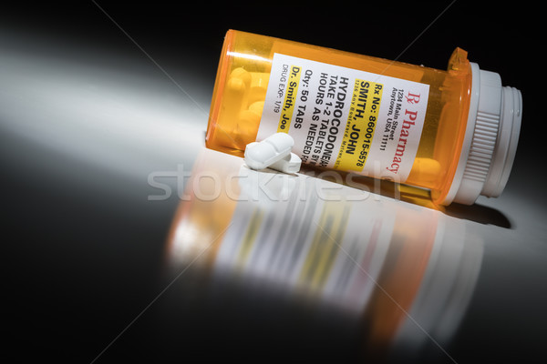Hydrocodone Pills and Prescription Bottle with Non Proprietary L Stock photo © feverpitch