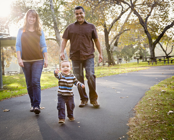 Happy Mixed Race Ethnic Family Walking In The Park Stock photo © feverpitch