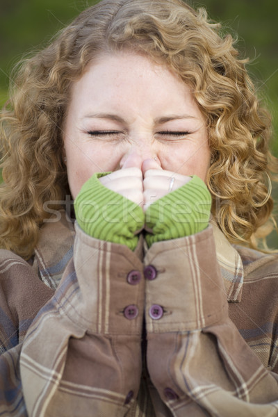 Pretty Young Woman Sneezing Stock photo © feverpitch