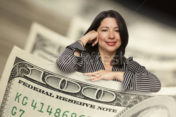 Hispanique femme une cent dollar Photo stock © feverpitch