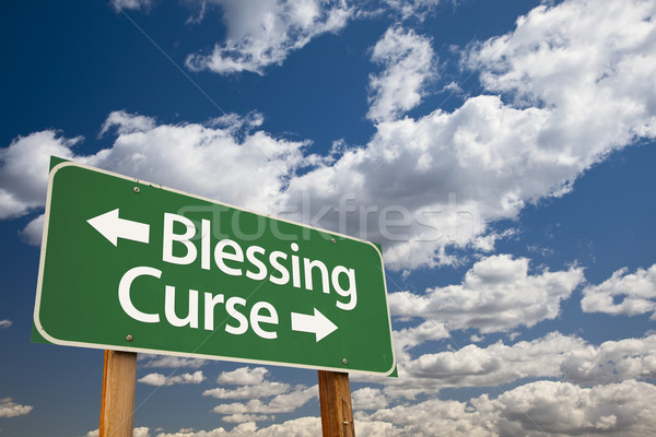 Blessing, Curse Green Road Sign and Clouds Stock photo © feverpitch