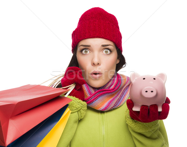 Concerned Mixed Race Woman Holding Shopping Bags and Piggybank Stock photo © feverpitch