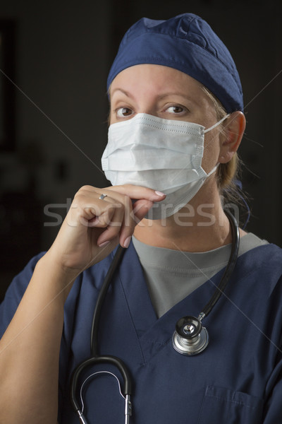 Female Doctor or Nurse Wearing Protective Face Mask  Stock photo © feverpitch