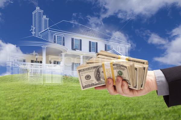 Handing Over Thousands of Dollars with Ghosted House Drawing Beh Stock photo © feverpitch