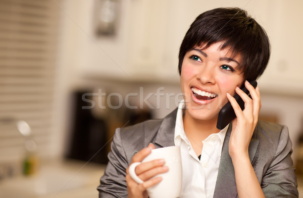 Multiethnic Woman with Coffee Talks on Cell Phone Stock photo © feverpitch
