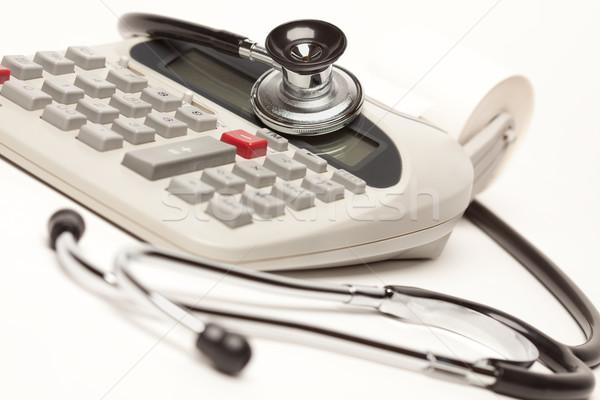 Black Stethoscope on Calculator Stock photo © feverpitch
