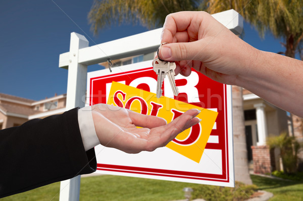 Agent Handing Over the Key to a New Home Stock photo © feverpitch