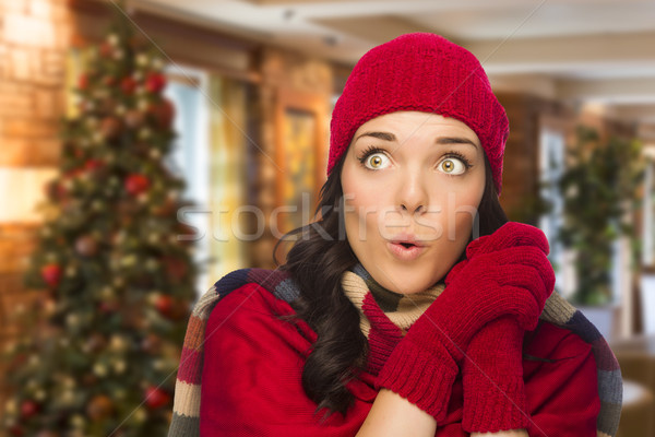 Stock photo: Mixed Race Woman Wearing Mittens and Hat In Christmas Setting