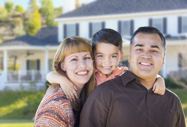 Happy Mixed Race Young Family in Front of House Stock photo © feverpitch