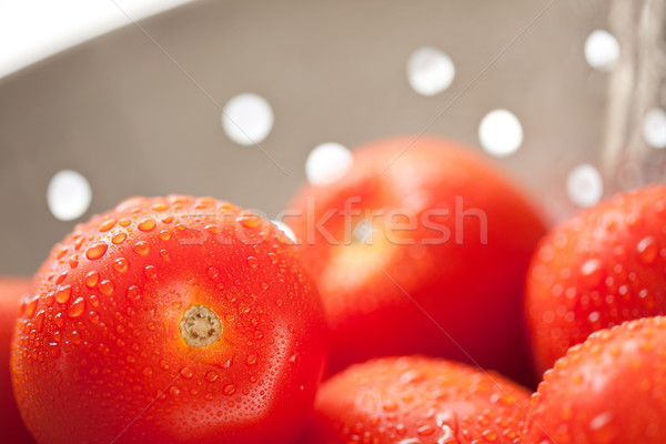 Fresh, Vibrant Roma Tomatoes in Colander with Water Drops Stock photo © feverpitch