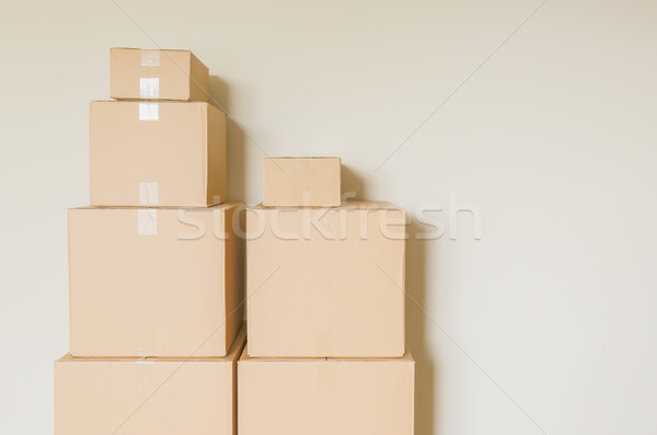 Packed Moving Boxes In Empty Room Stock photo © feverpitch