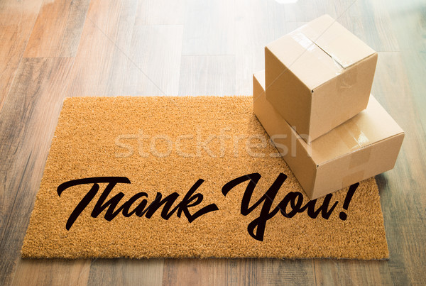 Thank You Welcome Mat On Wood Floor With Shipment of Boxes Stock photo © feverpitch