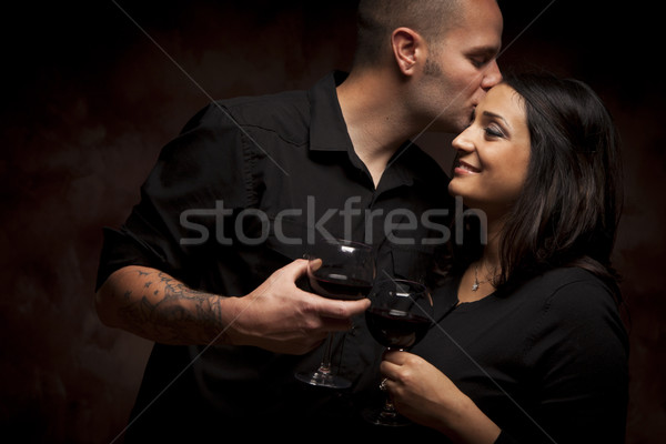 Stock photo: Happy Mixed Race Couple Flirting and Holding Wine Glasses