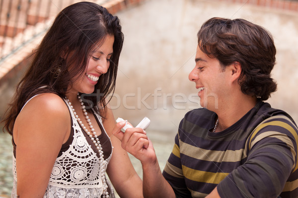 Happy Hispanic Man Proposing to His Love Stock photo © feverpitch