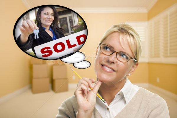 Woman In Empty Room with Thought Bubble of Agent Handing Over Ne Stock photo © feverpitch