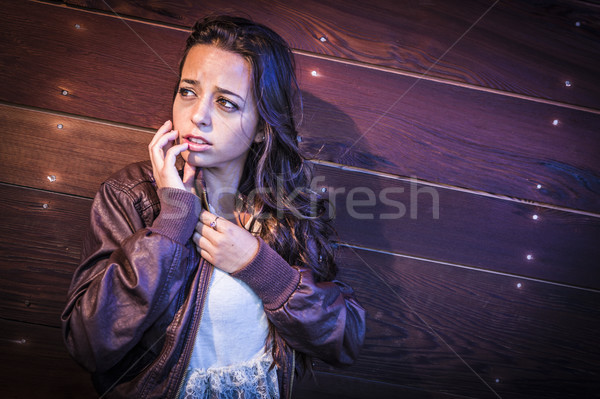 Frightened Pretty Young Woman in Dark Walkway at Night Stock photo © feverpitch