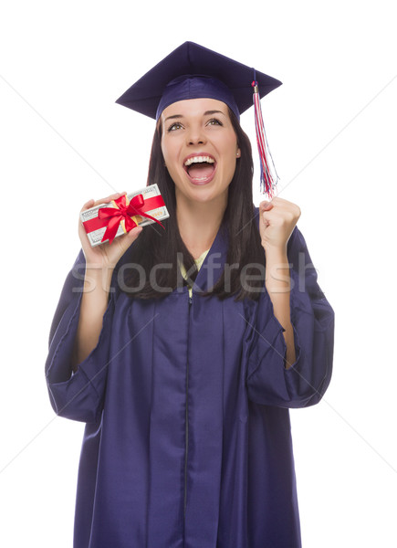 Stock photo: Female Graduate Holding Stack of Gift Wrapped Hundred Dollar Bil