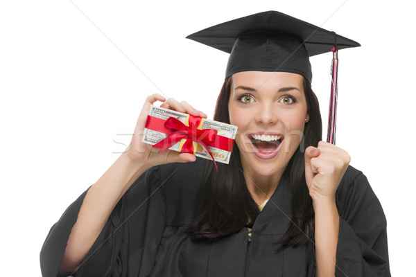 Female Graduate Holding Stack of Gift Wrapped Hundred Dollar Bil Stock photo © feverpitch