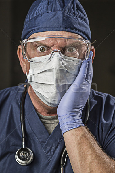 Stunned Doctor or Nurse with Protective Wear and Stethoscope Stock photo © feverpitch